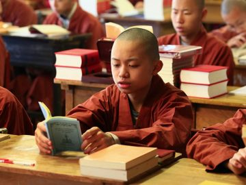 "Young Buddhist monk Venerable Xing-Shuo recites an ancient Indian classic called ""Ornament of Clear Realization"" at the Moonlight International Academy in Little Sands, PE. (Great Enlightenment Buddhist Institute Society)"