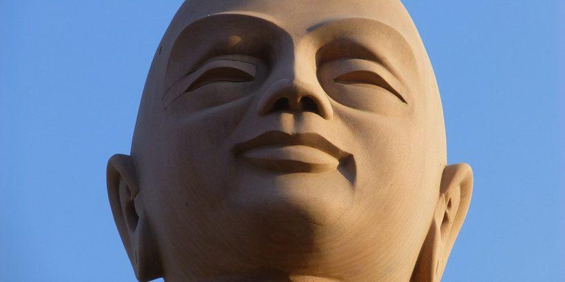 1200px-Bodh_Gaya_-_Buddha_Statue_-_Upali_(9227722130)